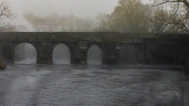 Bridge over river in fog img