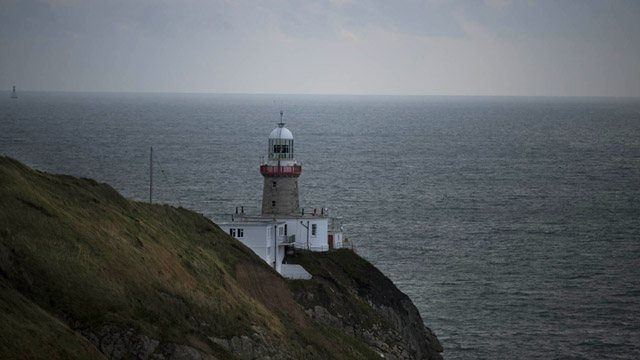 Lighthouse on a sea cliff image