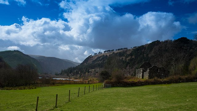 Old ruin by the mountainside image